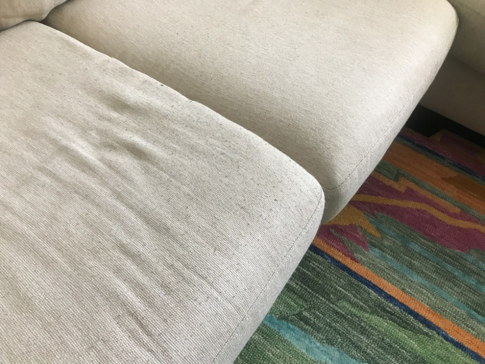 Not ready to replace your fabric couch? You can use a sweater shaver to remove pilling from upholstery to make your couches look new again!
