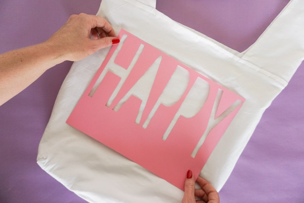 how to stencil for Yarn Embroidery: How to Embroider Letters (A HAPPY DIY Tote Bag)