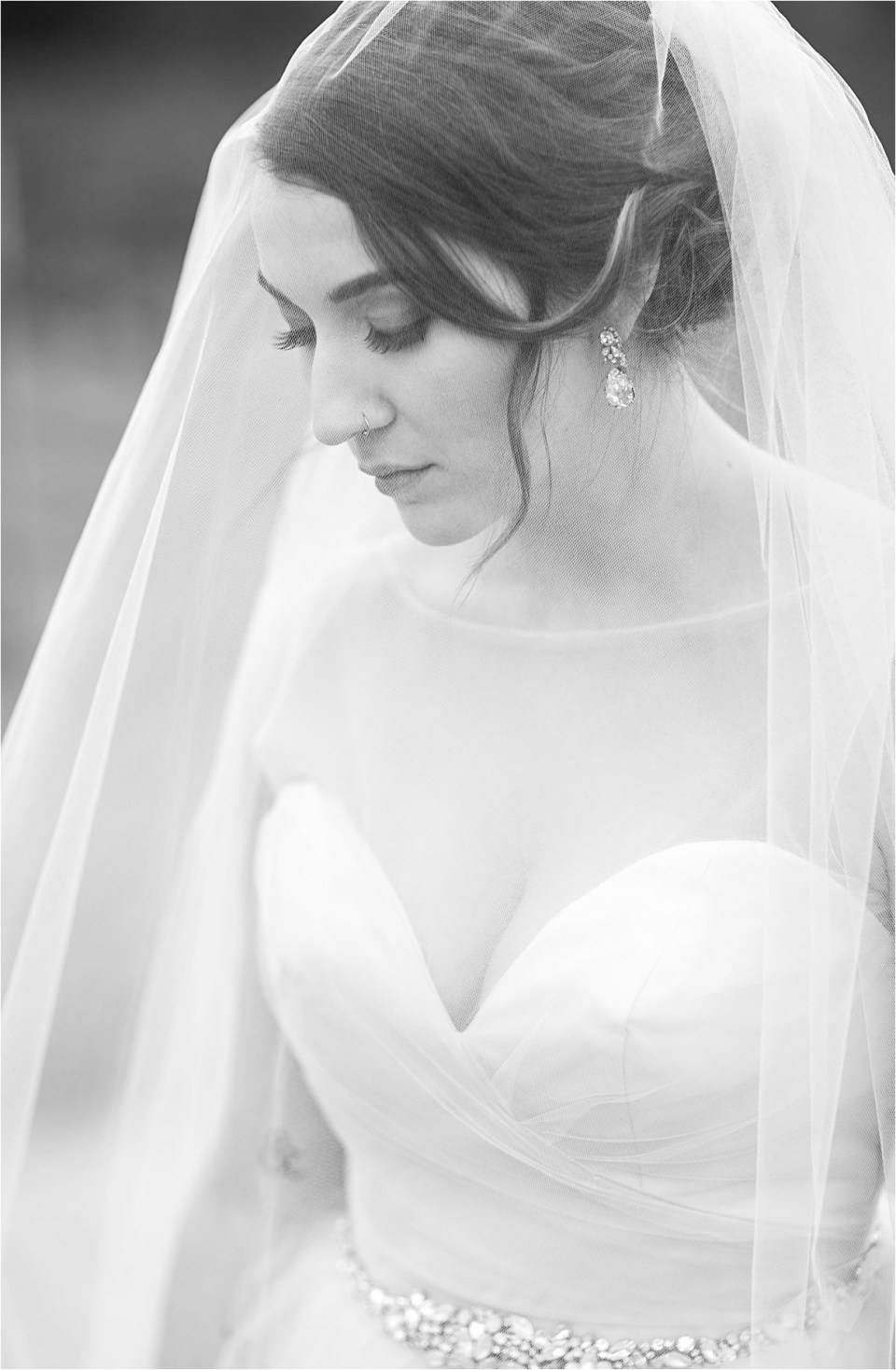 Black and white photo of Bride in a veil from Epiphany Bridal Boutique.