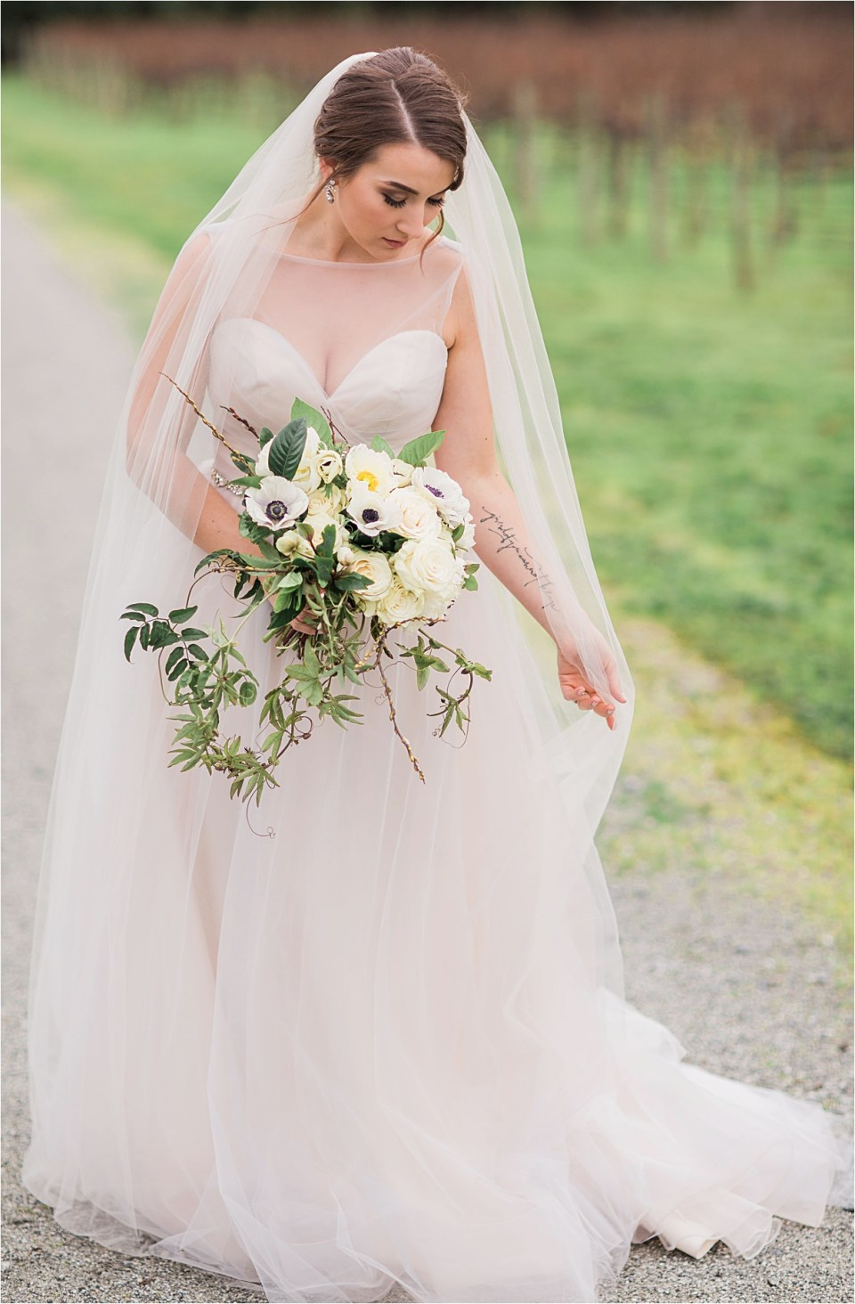 Hayley Paige blush wedding gown worn by a bride in Folktale Winery and Vineyard.