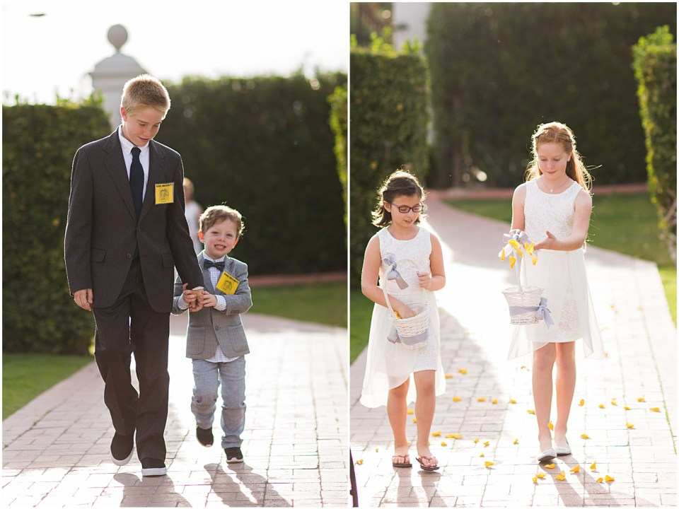 Ring bearer and flower girls walking down the aisle at the historic Arizona Inn in Tucson, Arizona