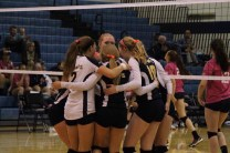 Avery, Becca, Hope, and Amber in a hudle after scoring a point.