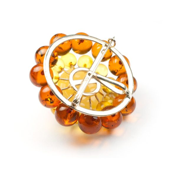 amber-brooch-with-silver-flower-backside
