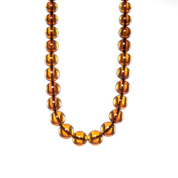 natural amber round beads bubbles close view