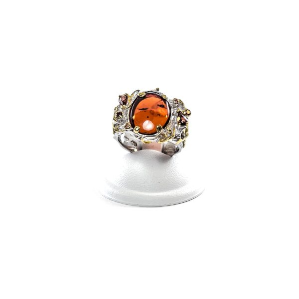 Spectacular ring with amber and garnet