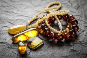 amber bracelet and pendant on dark background