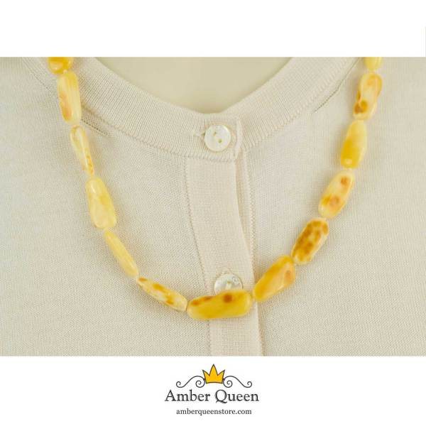 Bright Butterscotch Amber Necklace on Mannequin Close Up