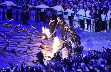 Athletes lighting the Olympic Cauldron, at London 2012 Olympics