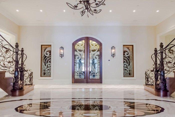 Chateau Inspired Custom Home - Foyer / Wine Cellar Custom glass doors design