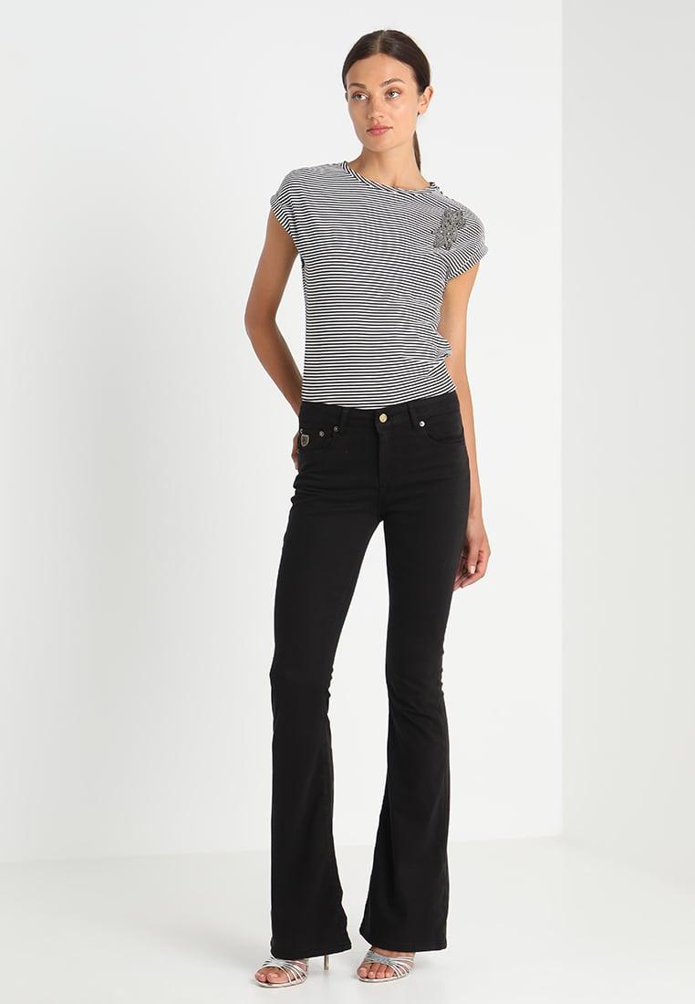 Sort viskose 'Raval' flare bukse Lois Jeans