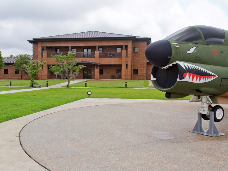 Military building and plane