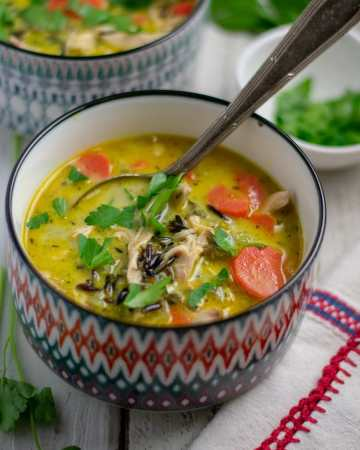 Chicken Black Rice Soup in patterned bowls with spoon