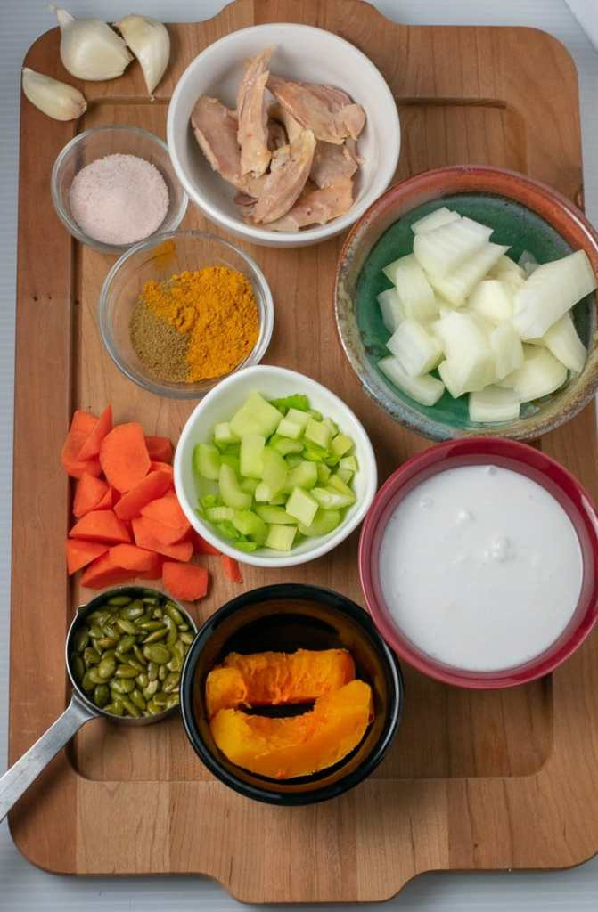 Ingredients for Butternut Squash curry soup on wooden tray