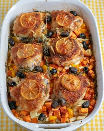 Roasted chicken with vegetables in baking dish after roasting