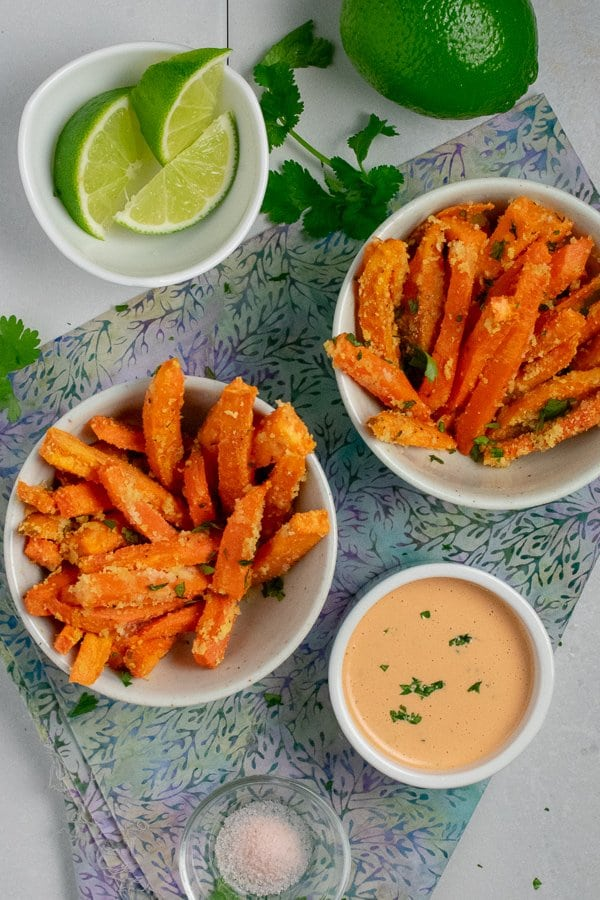 roasted sweet potato fries in small bowls with mayo overhead view