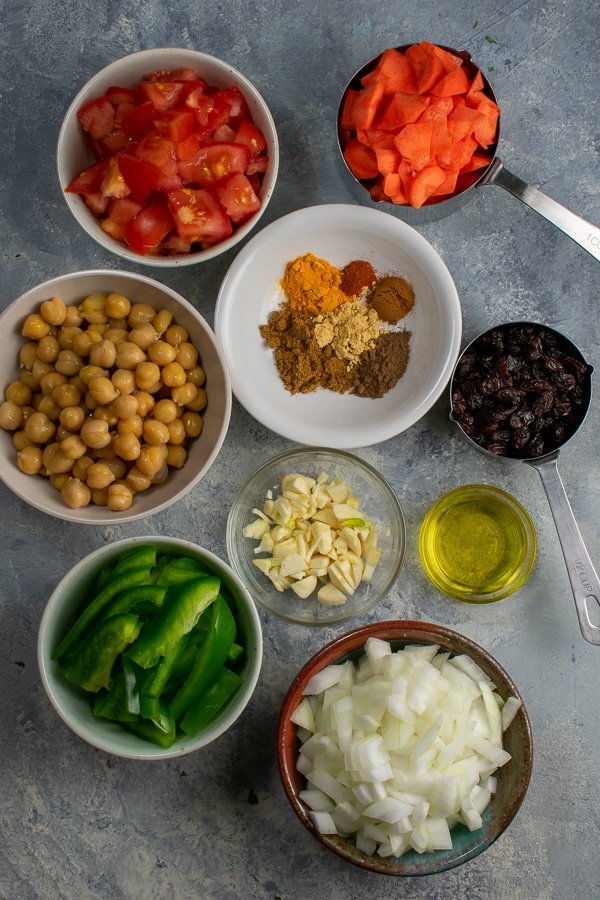 Moroccan stew 2 ways ingredients in small bowls overhead view