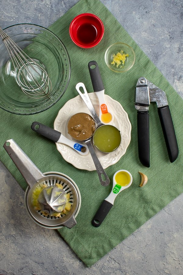 ingredients for tahini garlic dressing on green napkin