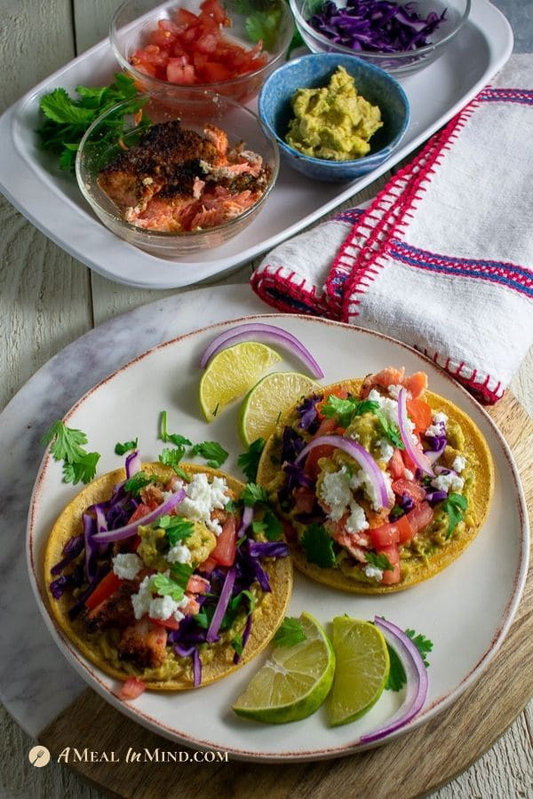 beautiful almond-crusted steelhead tacos with toppings