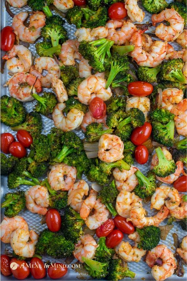 savory shrimp with broccoli and tomatoes overhead view