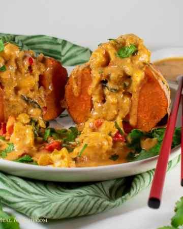 square image of thai massaman curry stuffed sweet potato on white plate