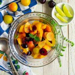 refreshing stone fruit salad in glass bowl