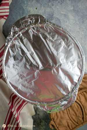 dutch oven covered with foil for marrakesh lamb curry