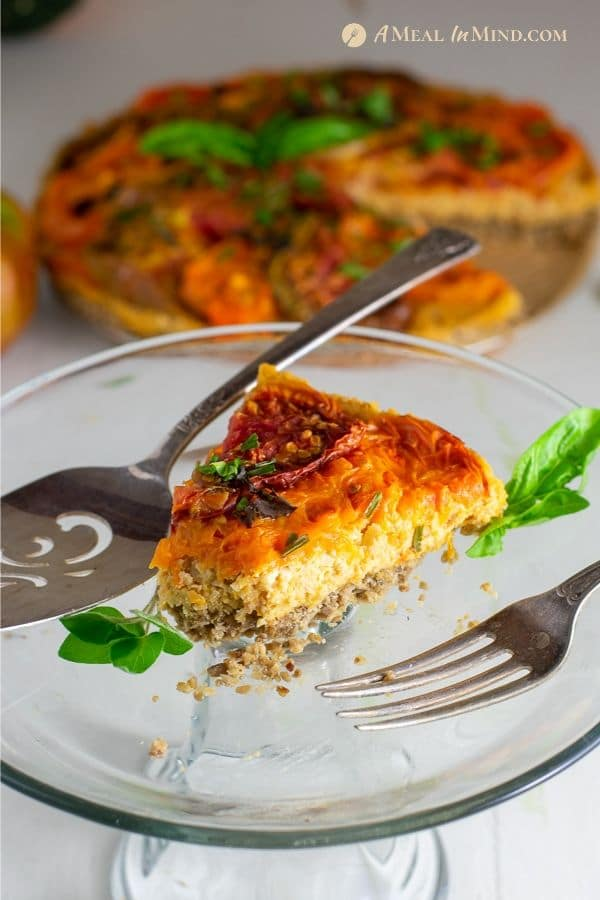 slice of savory roasted heirloom tomato tart with chickpea-walnut filling