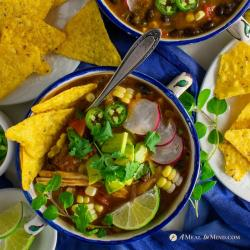 savory roasted hatch green chile tortilla soup in patterned bowls