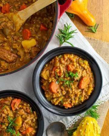 easy beef barley pumpkin stew in black bowls