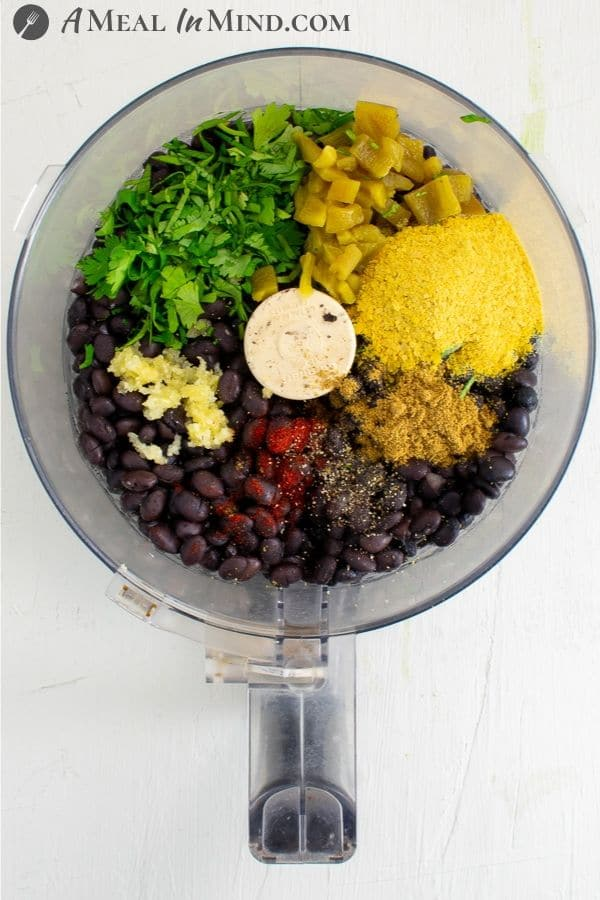 ingredients for cheese green chile black bean dip in food processor