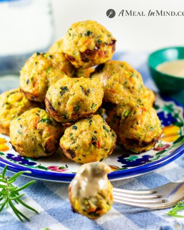 chicken vegetable meatballs on small plate with sauce