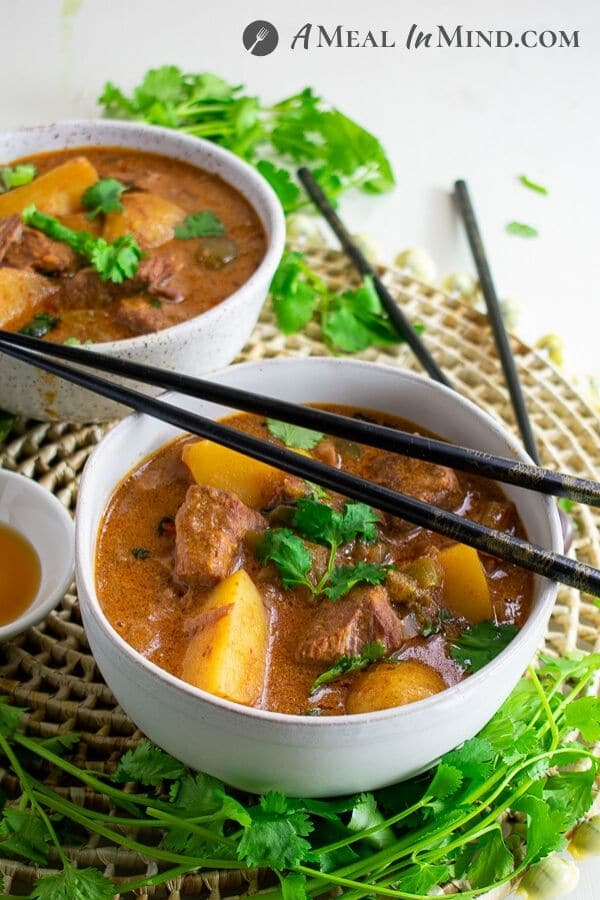 thai massaman curry with beef and potatoes in bowls
