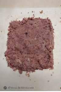 pink dough for cranberry almond-flour pinwheel cookies on parchment paper