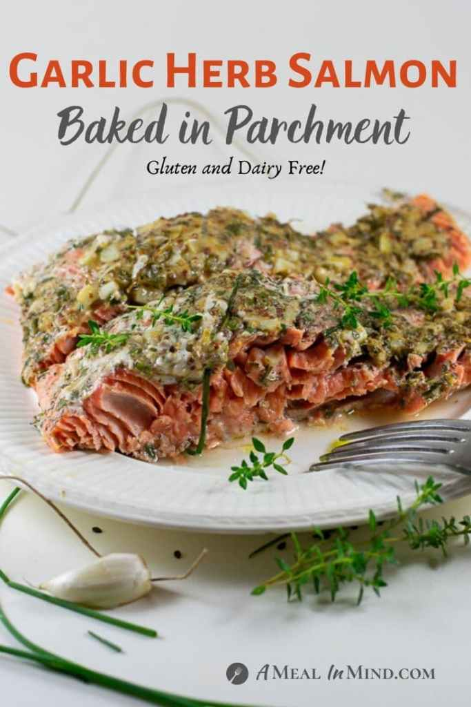 Garlic Herb Salmon Baked in Parchment side view on white plate