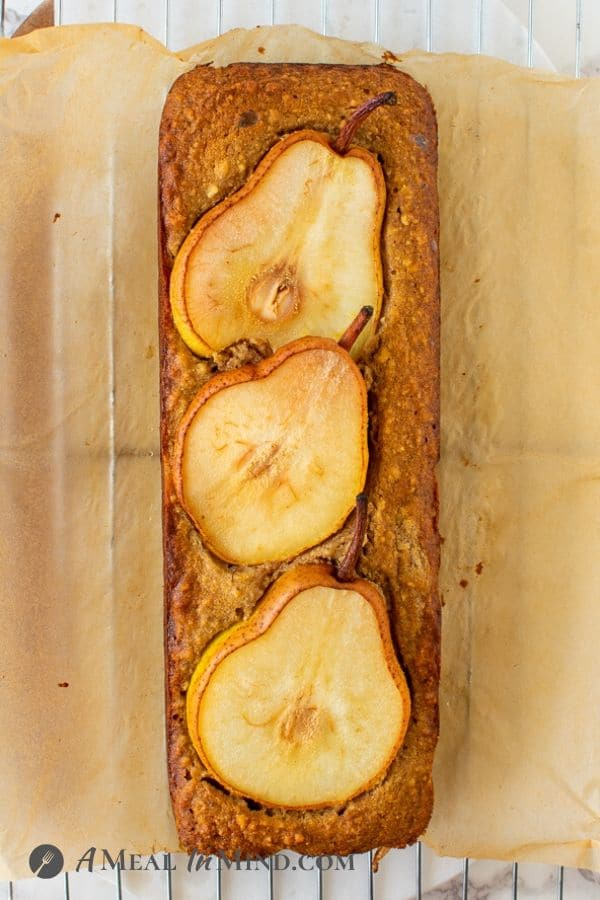 Walnut-Ginger Pear Bread baked and with parchment partly removed