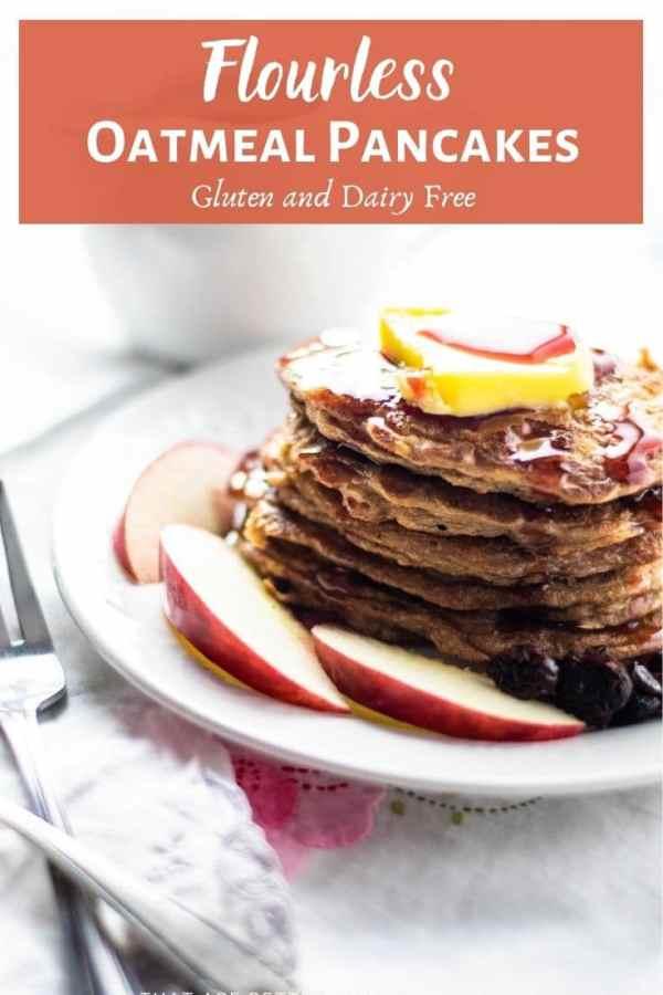 flourless oatmeal pancakes on white plate with fresh fruit