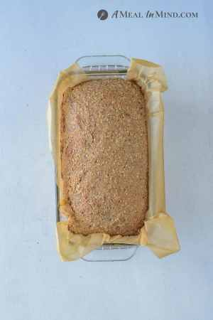 Low Carb Nut and Seed Bread in parchment-lined baking pan