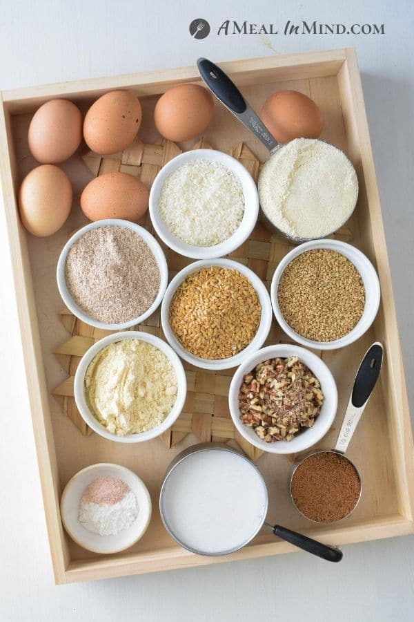 ingredients for Low Carb Nut and Seed Bread on wooden tray