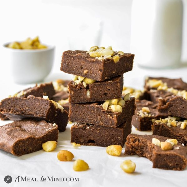 "Macadamia Nut""Ella"" Brownies 3 Ingredient stacked on table"