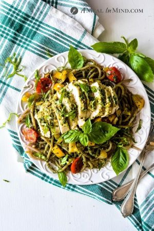 Pesto Chicken Pasta on white plate from overhead