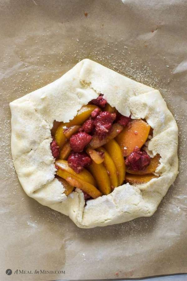 Gluten-Free Plumcot-Raspberry Galette ready to bake on parchment