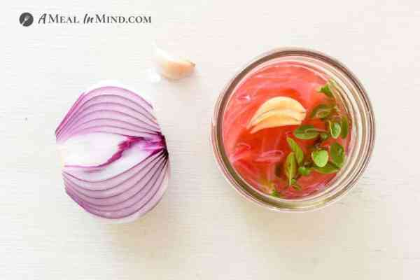 Pickled Red Onions in half pint Mason jar with onion