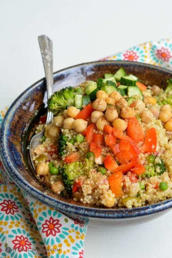 Mexican Quinoa Bowl with Corn and Peppers in ceramic bowl with cumin