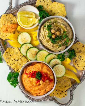 Eggplant and Red Bell Pepper Hummus Platter on silver tray