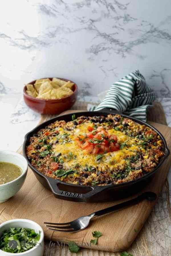 beef green chile quinoa skillet on wood board