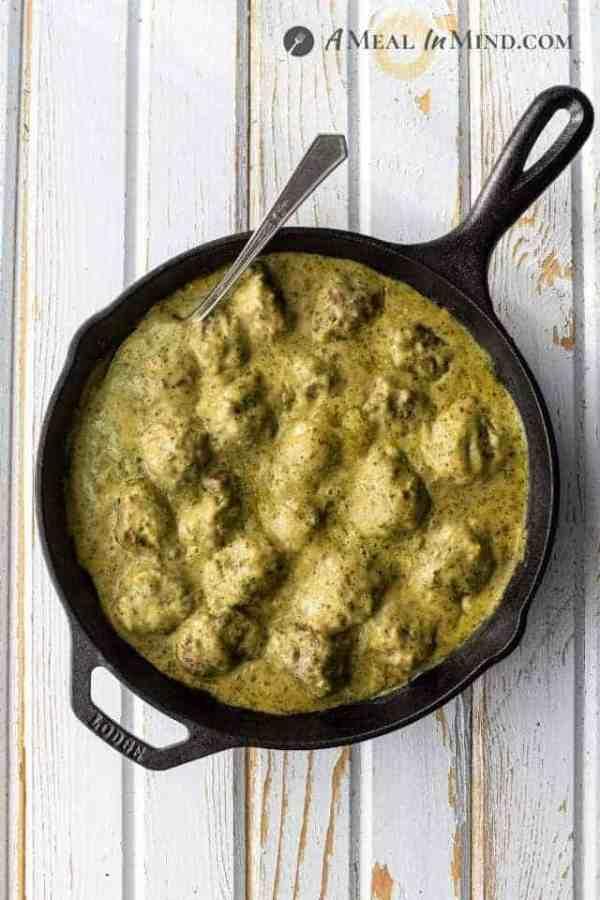 Pesto Meatballs in Alfredo Sauce in skillet