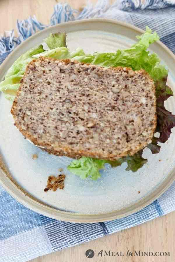 overhead view of chicken-apple-brie sandwich on paleo seed bread