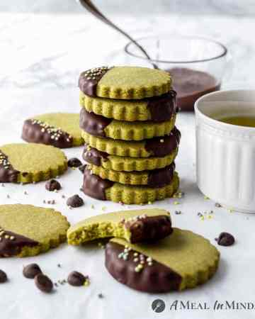stack of chocolate-dipped matcha cookies