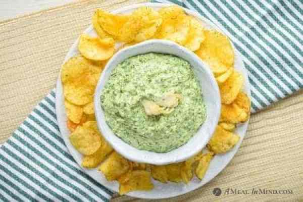 overhead view of spinach-artichoke dip surrounded by potato chips