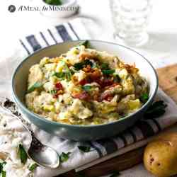 irish colcannon in white bowl with bacon